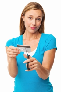 Woman Cutting Her Credit Card - Isolated
